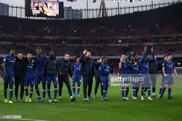 Frank Lampard Manager of Chelsea celebrates with his players following their victory in the Premier League match between Arsenal FC and Chelsea FC at...