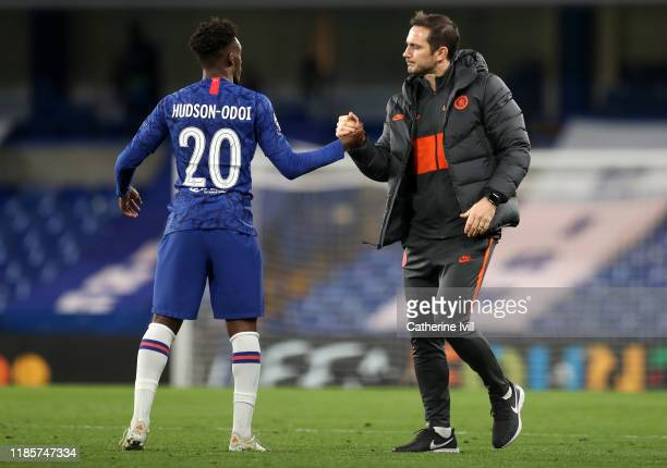 Frank Lampard Manager of Chelsea embraces Callum HudsonOdoi during the UEFA Champions League group H match between Chelsea FC and AFC Ajax at...