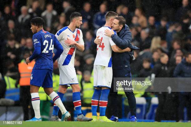 Frank Lampard Manager of Chelsea embraces Gary Cahill of Crystal Palace following the Premier League match between Chelsea FC and Crystal Palace at...