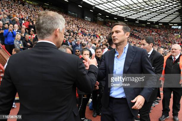 Frank Lampard Manager of Chelsea embraces Ole Gunnar Solskjaer Manager of Manchester United prior to the Premier League match between Manchester...