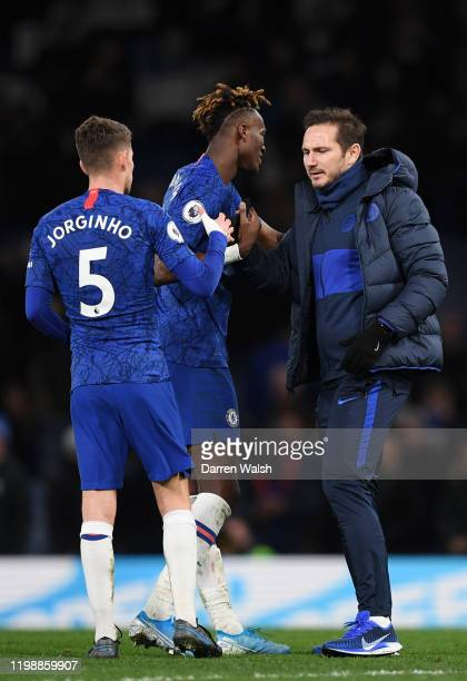 Frank Lampard, Manager of Chelsea embraces Tammy Abraham of Chelsea and Jorginho during the Premier League match between Chelsea FC and Burnley FC at...