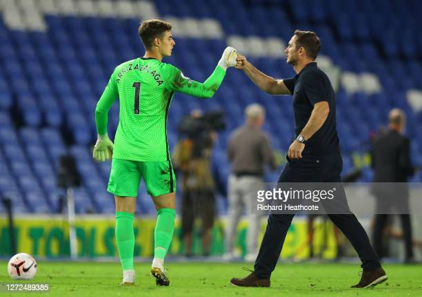 Frank Lampard, Manager of Chelsea fist bumps Kepa Arrizabalaga of Chelsea following the Premier League match between Brighton & Hove Albion and...