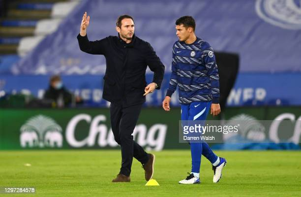 Frank Lampard, Manager of Chelsea gives instructions to Thiago Silva of Chelsea during the warm up ahead of the Premier League match between...