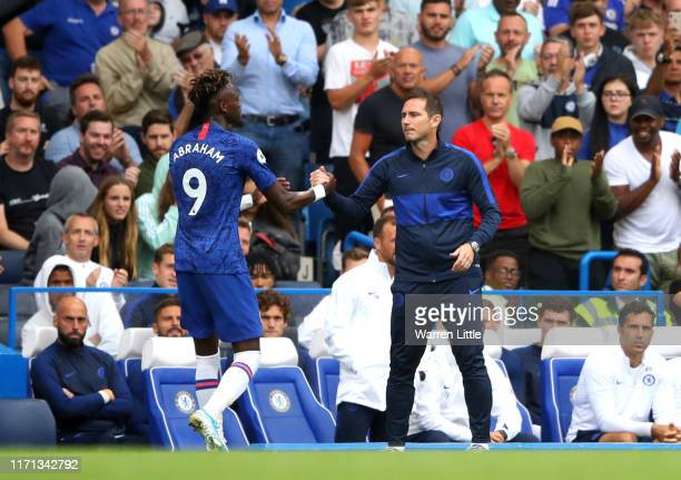 Frank Lampard Manager of Chelsea greets Tammy Abraham of Chelsea as he is substituted off during the Premier League match between Chelsea FC and...