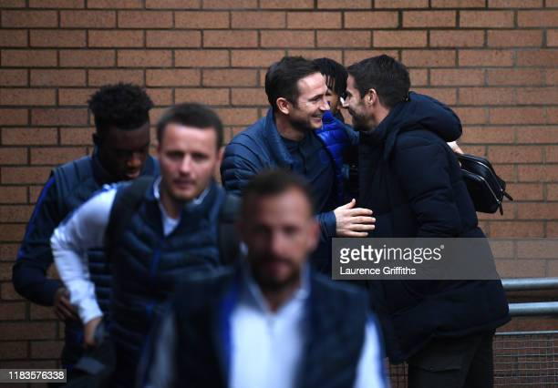 Frank Lampard Manager of Chelsea greets TV Pundit Jamie Redknapp prior to the Premier League match between Burnley FC and Chelsea FC at Turf Moor on...