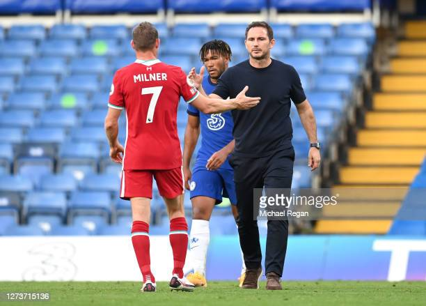 Frank Lampard Manager of Chelsea interacts with James Milner of Liverpool after the Premier League match between Chelsea and Liverpool at Stamford...