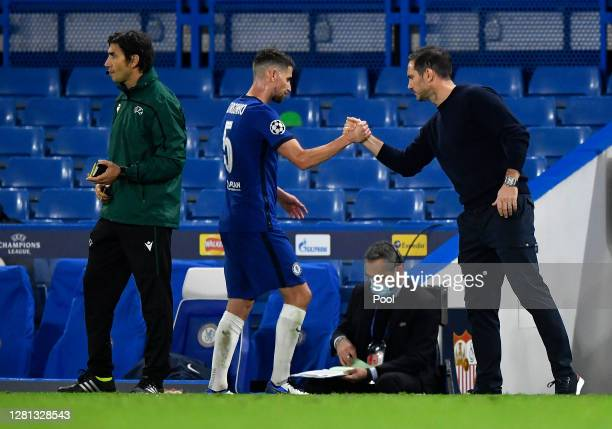 Frank Lampard, Manager of Chelsea interacts with Jorginho of Chelsea as he is substituted during the UEFA Champions League Group E stage match...