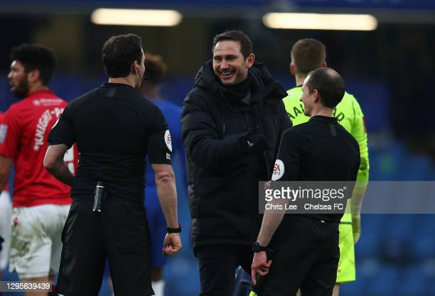 Frank Lampard, Manager of Chelsea interacts with match referee, Darren England following the FA Cup Third Round match between Chelsea and Morecambe...