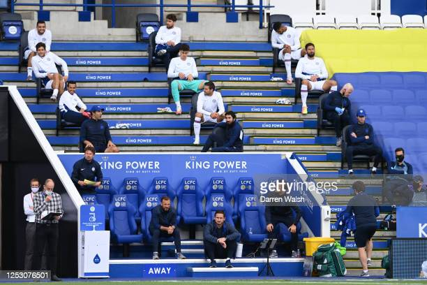 Frank Lampard, Manager of Chelsea looks on from the bench and his players sit around him socially distanced during the FA Cup Fifth Quarter Final...