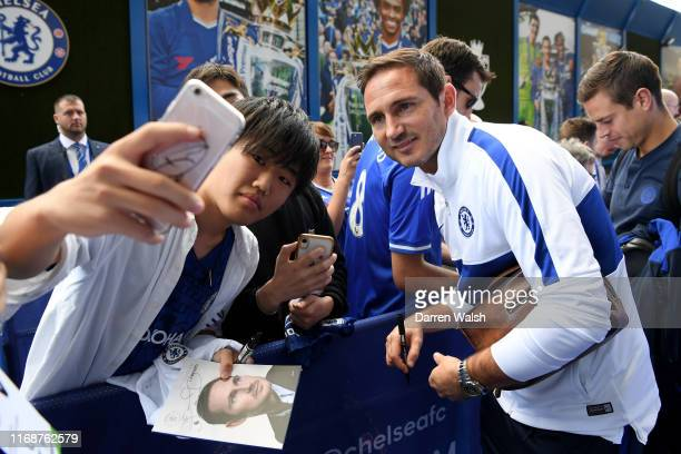 Frank Lampard Manager of Chelsea poses for a selfie as he arrives at the stadium prior to the Premier League match between Chelsea FC and Leicester...