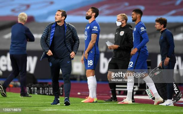 Frank Lampard, Manager of Chelsea prepares to bring on substitutes Olivier Giroud and team mate Ruben Loftus-Cheek of Chelsea during the Premier...