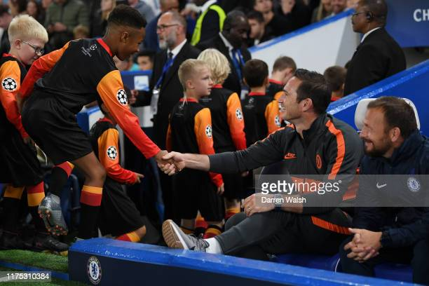 Frank Lampard Manager of Chelsea shakes hands with mascots prior to the UEFA Champions League group H match between Chelsea FC and Valencia CF at...