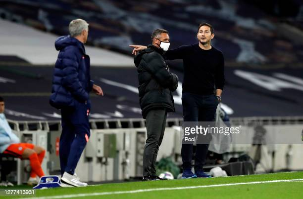 Frank Lampard, Manager of Chelsea speaks with Jose Mourinho, Manager of Tottenham Hotspur during the Carabao Cup fourth round match between Tottenham...
