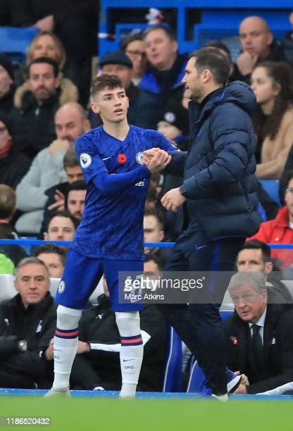 Frank Lampard Manager of Chelsea talks to Billy Gilmour of Chelsea as he prepares to be substituted onto the pitch during the Premier League match...