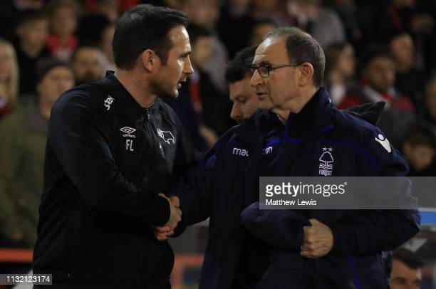 Frank Lampard manager of Derby County and Martin O'Neill manager of Nottingham Forest shake hands before the Sky Bet Championship match between...