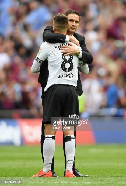 Frank Lampard Manager of Derby County consoles Mason Mount of Derby County following defeat in the Sky Bet Championship Playoff Final match between...