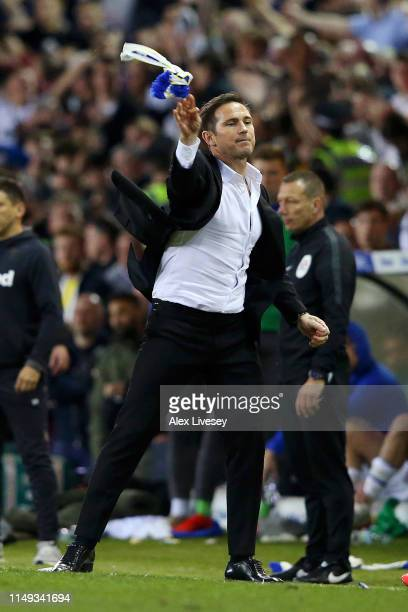 Frank Lampard, Manager of Derby County throws a Leeds scarf after it was thrown at him during the Sky Bet Championship Play-off semi final second leg...