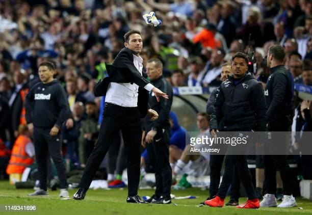 Frank Lampard Manager of Derby County throws a Leeds scarf after it was thrown at him during the Sky Bet Championship Playoff semi final second leg...
