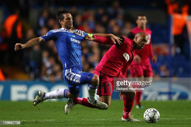 Frank Lampard of Chelsea and Anthony Vanden Borre of KRC Genk battle for the ball during the UEFA Champions League Group E match between Chelsea and...