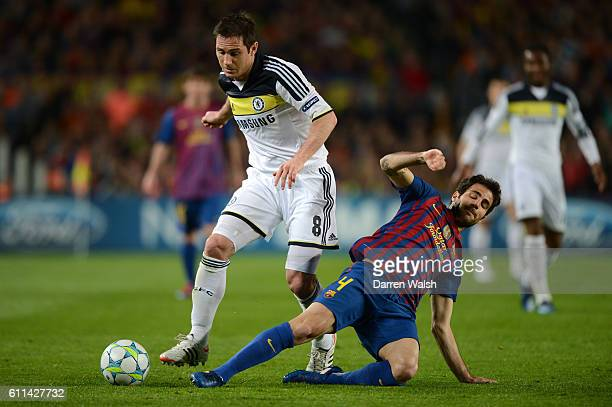 Frank Lampard of Chelsea and Cesc Fabregas of Barcelona battle for the ball during the UEFA Champions League Semi Final second leg match between FC...