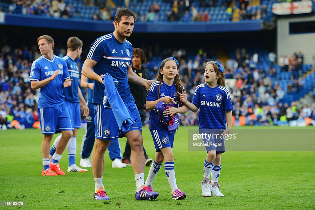 Frank Lampard of Chelsea and his daughters Luna and Isla appear on the pitch following the Barclays Premier League match between Chelsea and Norwich City at Stamford Bridge on May 4, 2014 in London, England.
