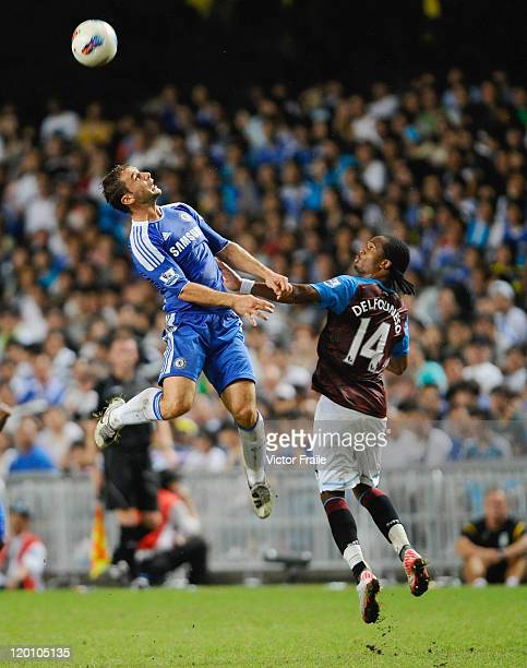 Frank Lampard of Chelsea and Nathan Albrigton of Aston Villa jump for the ball during the Asia Trophy Final match at the Hong Kong Stadium on July 30...