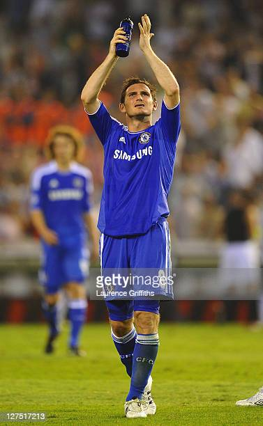 Frank Lampard of Chelsea applauds the travelling fans after the UEFA Champions League Group E match between Valencia CF and Chelsea at the Estadio...