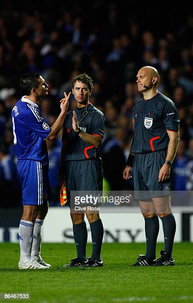 Frank Lampard of Chelsea argues with referee Tom Henning Ovrebo during the UEFA Champions League Semi Final Second Leg match between Chelsea and...