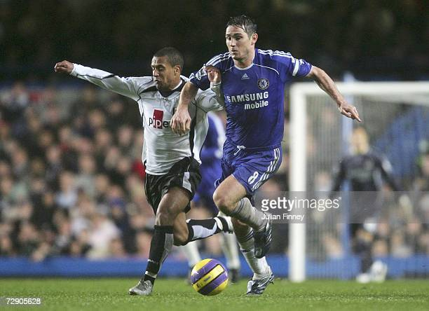Frank Lampard of Chelsea battles with Wayne Routledge of Fulham during the Barclays Premiership match between Chelsea and Fulham at Stamford Bridge...