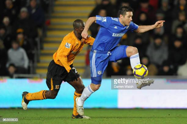 Frank Lampard of Chelsea beats George Boateng of Hull City to the ball during the Barclays Premier League match between Hull City and Chelsea at the...