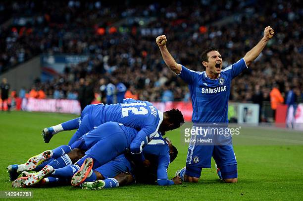 Frank Lampard of Chelsea celebrates as Ramires scores their third goal during the FA Cup with Budweiser Semi Final match between Tottenham Hotspur...