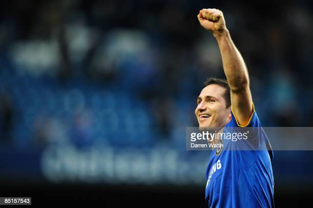 Frank Lampard of Chelsea celebrates following the Barclays Premier League match between Chelsea and Wigan Athletic at Stamford Bridge on February 28...