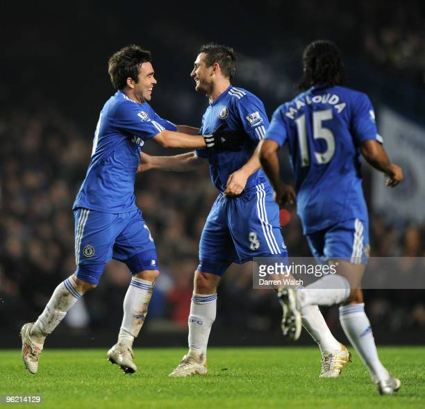 Frank Lampard of Chelsea celebrates his goal with team mate Deco during the Barclays Premier League match between Chelsea and Birmingham City at...