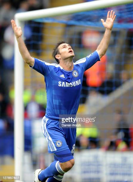 Frank Lampard of Chelsea celebrates scoring his team's second goal during the Barclays Premier League match between Bolton Wanderers and Chelsea at...