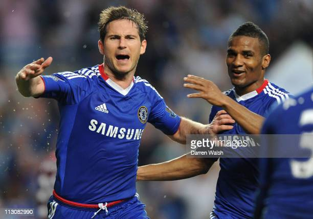 Frank Lampard of Chelsea celebrates scoring the opening goal with team mate Florent Malouda during the Barclays Premier League match between Chelsea...