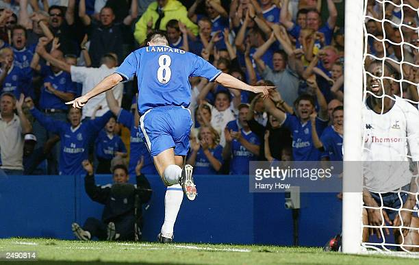 Frank Lampard of Chelsea celebrates scoring their first goal as Ledley King of Tottenham Hotspur looks dejected during the FA Barclaycard Premiership...