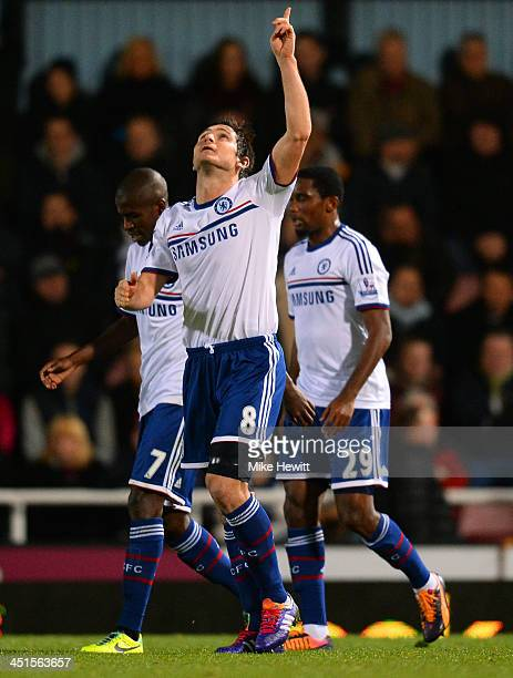 Frank Lampard of Chelsea celebrates scoring their first goal from the penalty spot during the Barclays Premier League match between West Ham United...