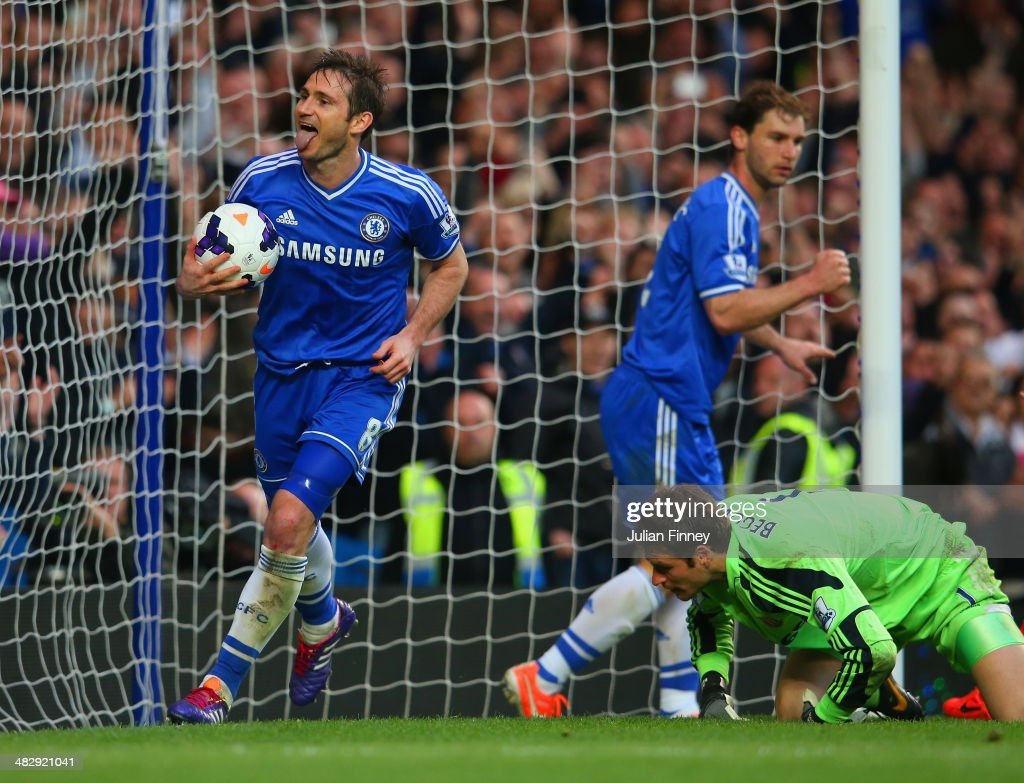 Frank Lampard of Chelsea celebrates scoring their second goal from the rebound of his penalty during the Barclays Premier League match between Chelsea and Stoke City at Stamford Bridge on April 5, 2014 in London, England.