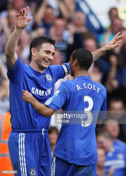 Frank Lampard of Chelsea celebrates with Ashley Cole as he scores their fifth goal during the Barclays Premier League match between Chelsea and Stoke...