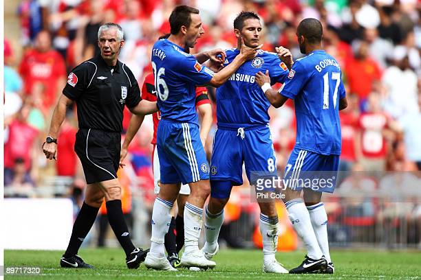 Frank Lampard of Chelsea celebrates with John Terry and Jose Bosingwa as he scores their second goal during the FA Community Shield match between...