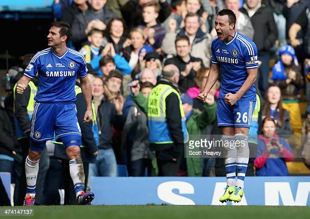 Frank Lampard of Chelsea celebrates with John Terry as he scores their first goal during the Barclays Premier League match between Chelsea and...