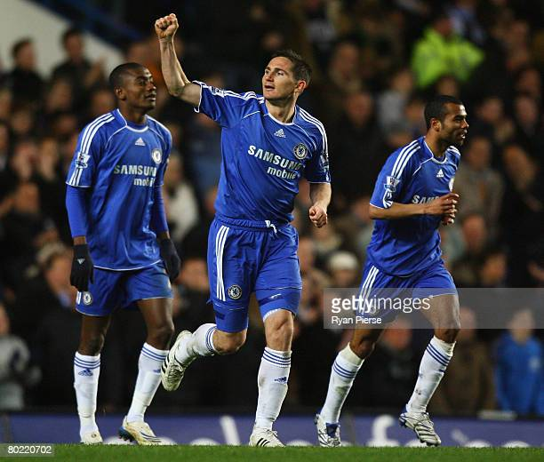 Frank Lampard of Chelsea celebrates with Salomon Kalou and Ashley Cole as he scores their third goal during the Barclays Premier League match between...