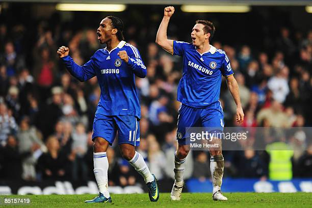 Frank Lampard of Chelsea celebrates with team mate Didier Drogba following the Barclays Premier League match between Chelsea and Wigan Athletic at...