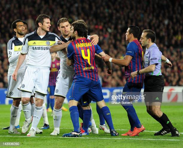 Frank Lampard of Chelsea clashes with Cesc Fabregas of Barcelona during the UEFA Champions League Semi Final second leg match between FC Barcelona...