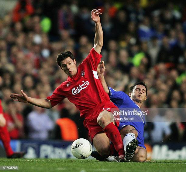 Frank Lampard of Chelsea clashes with Xabi Alonso of Liverpool during the UEFA Champions League semi-final first leg match between Chelsea and...