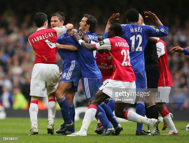 Frank Lampard of Chelsea fights with Cesc Fabregas of Arsenal during the Carling Cup Final match between Chelsea and Arsenal at the Millennium...