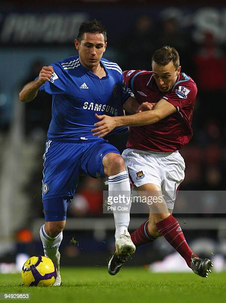 Frank Lampard of Chelsea is challenged by Mark Noble of West Ham United during the Barclays Premier League match between West Ham United and Chelsea...