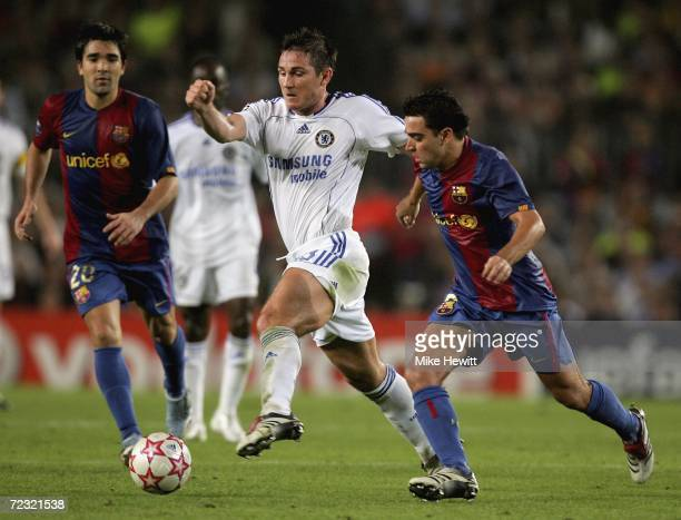 Frank Lampard of Chelsea is challenged by Xavi of Barcelona as Deco looks on during the UEFA Champions League group A match between Barcelona and...