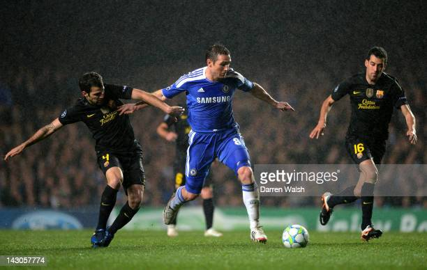 Frank Lampard of Chelsea is closed down by Cesc Fabregas and Sergio Busquets of Barcelona during the UEFA Champions League Semi Final first leg match...