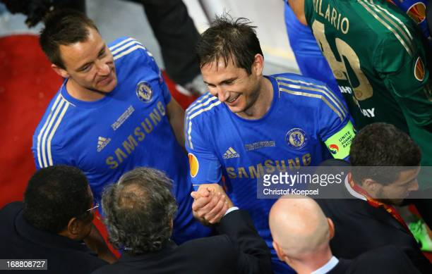 Frank Lampard of Chelsea is congratulated by UEFA President Michel Platini during the UEFA Europa League Final between SL Benfica and Chelsea FC at...